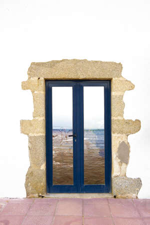 Typical door of a fisher rustic house in the Costa Brava, Catalonia, Spain. photo