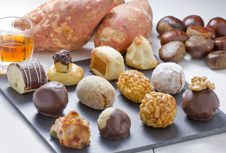 Panellets, chestnut, sweet potatoes and moscatell, are traditional desserts of All Saints holiday. known as Castanyada in Catalonia, Spain Stock Photo