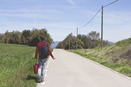 hitchhiking: hipster doing hitchhiking in the road