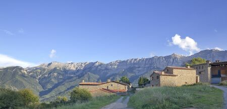 Estana, typical village of Cerdanya with Serra del Cadi in the background, Catalonia (Spain) Stock Photo