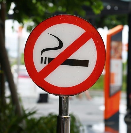 cigar smoke: No smoking sign on public place background