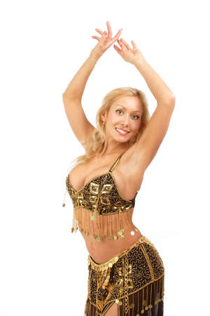Beautiful blondie in golden-black bellydance costume posing with hands up