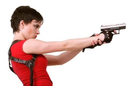 Young brunette girl in red tee-shirt and with holster on her back holding air pistol  photo