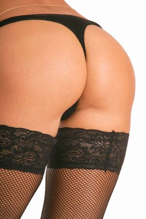 Beautiful buttocks of tanned sportive woman in black panties and stockings Stock Photo - 1194481