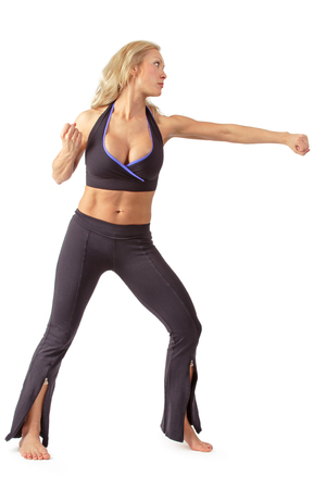 female muscle: Athletic tanned blond girl training tae bo Stock Photo