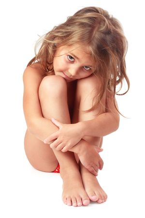 frizz: Little girl with matted blond hair sitting and embracing her legs