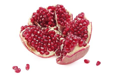 stilllife: Still-life with broken juicy pomegranate on white background