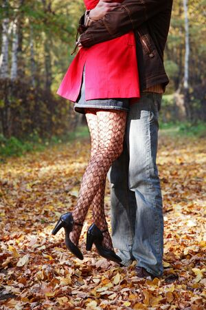 Romantic couple in the sunny autumn park photo