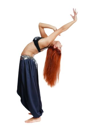 Red-headed bellydancer in oriental costume bending backwards Stock Photo