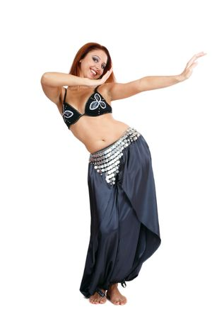 Pretty smiling bellydancer in costume dancing gracefully Stock Photo