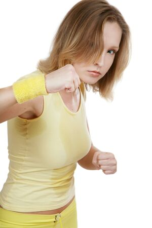 sweaty: Sportive agressive blond girl in yellow fitness outfits training tae-bo Stock Photo