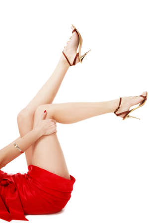 Long legs in stilettos of woman lying on white background Stock Photo - 2198074