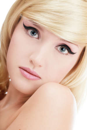 Close-up portrait of beautiful blond young girl with trendy makeup