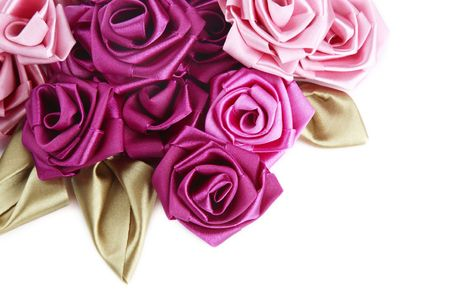 Vinous and pink handmade silk roses on white background with copy space below Stock Photo