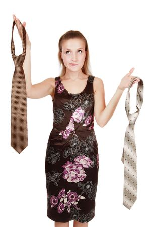 Pretty girl holding in hands mens ties and choosing one of them... or maybe one of two men?