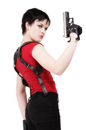 mujer con pistola: Joven morena chica en guantes de cuero con pistola y funda de pistola