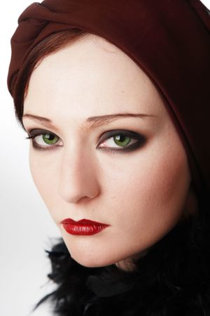 Portrait of beautiful green-eyed girl with makeup in twenties style photo