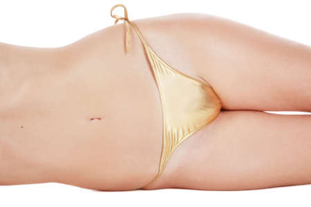 Abdomen and hips of slim woman in golden bikini lying on white background Stock Photo - 2861977