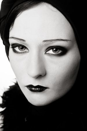 silent film: Black and white portrait of woman with makeup in style of vintage silent film