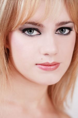 Portrait of pretty young girl with smoky eyes, selective focus Stock Photo - 3085798