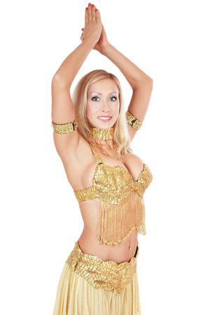 Beautiful smiling bellydancer posing with hands up Stock Photo