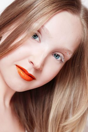 Portrait of pretty blonde girl with orange lipstick, selective focus Stock Photo - 3085808