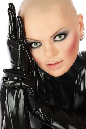 Portrait of bold girl in black latex catsuit photo