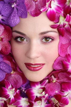 Portrait of beautiful young girl in orchids Stock Photo - 3351457