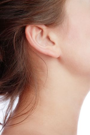 human ear: Close-up shot of young womans neck and ear Stock Photo