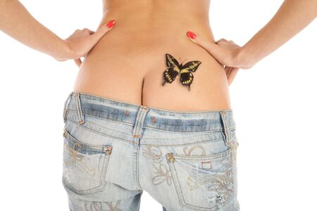 Back of slim sexy tanned girl in blue jeans with butterfly painted on her right buttock  photo