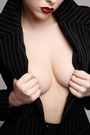 Torso of y woman in stylish black jacket put on naked body