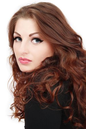 Portrait of beautiful blue-eyed girl with gorgeous curling hair and trendy makeup Stock Photo
