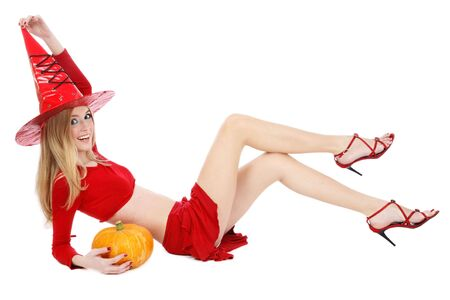 Beautiful blond girl with long legs in costume of Halloween witch lying on white background and smiling Stock Photo - 3692756