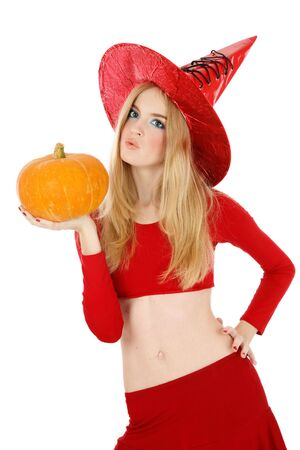 Pretty blond girl in costume of Halloween witch with pumpkin in hand Stock Photo - 3692758