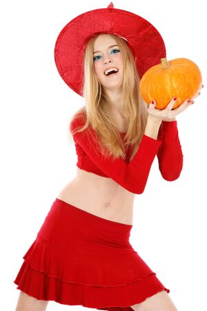 Beautiful blond laughing girl in costume of Halloween witch holding pupmkin in hands Stock Photo - 3704486