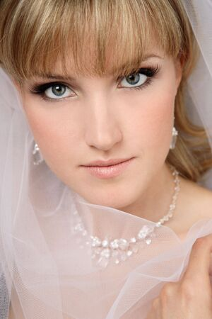 veil: Close-up portrait of young beautiful bride in bridal veil