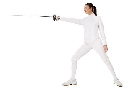 esgrima: Slim chica en traje de esgrima con espada en mano sobre fondo blanco Foto de archivo