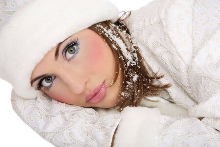 Pretty fresh girl in costume of Santa helper with snowflakes in hair