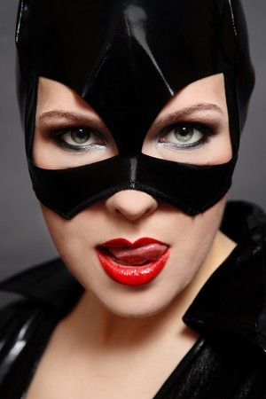 roleplaying: Portrait of sexy woman in catwoman black vinyl mask