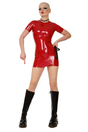Slim skinhead woman in red latex dress and high boots over white background photo