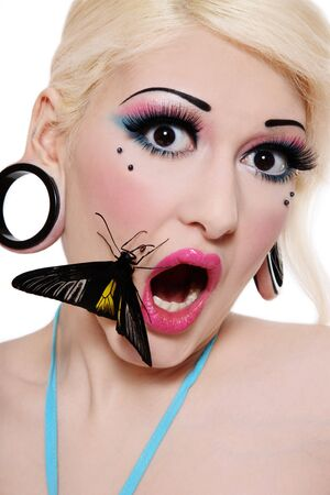 entice: Beautiful blond scared girl with bright makeup and big tropical butterfly on her face