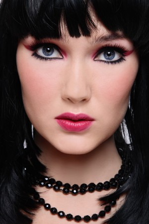 Close-up portrait of beautiful brunette with stylish pink and black makeup photo
