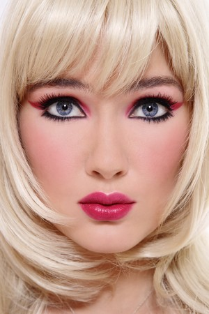 Close-up portrait of beautiful blonde with stylish pink and black makeup Stock Photo