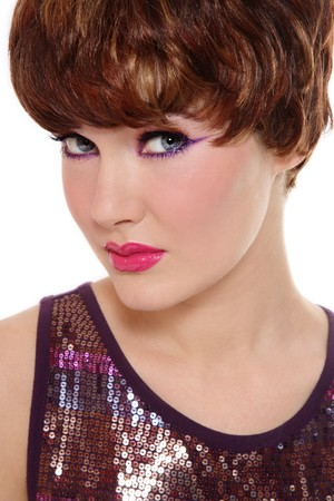 Portrait of beautiful redhead girl with stylish sparkly makeup over white background photo