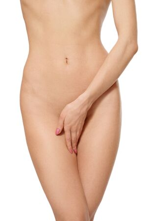Perfect torso of slim tanned woman over white background Stock Photo - 4344875
