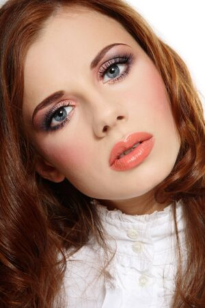 allure: Portrait of beautiful young redhead girl with stylish makeup