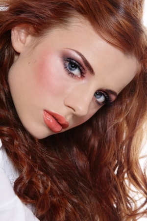 allure: Portrait of beautiful young redhead girl with trendy makeup