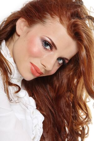 entice: Portrait of beautiful young girl with gorgeous red hair and stylish makeup