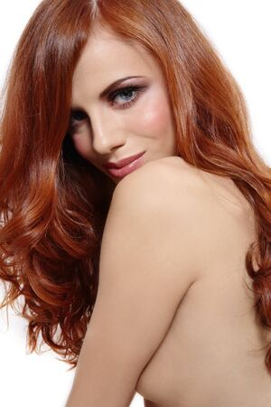 allure: Portrait of beautiful young girl with gorgeous red hair and stylish makeup