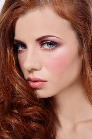 allure: Close-up portrait of young fresh beautiful redhead girl